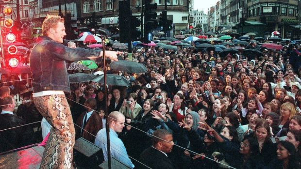 "Pop singer Ronan Keating performs his UK single ""Life is a Rollercoaster"" in front of 2000 drenched fans outside the new HMV store in Oxford Street on May 21, 2000"