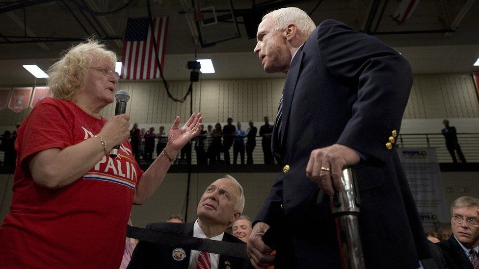 US Republican presidential candidate Senator John McCain (R) takes a question from a supporter (L), who called US Democratic presidential candidate Barack Obama an Arab, during a town hall meeting in Lakeville, Minnesota, October 10, 2008.