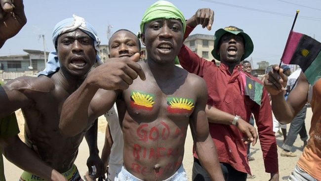 Pro-Biafra supporters shout slogans in Aba, south-eastern Nigeria, during a protest calling for the release of a key activist on November 18, 2015