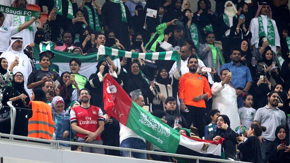 """Saudi families cheer at the King Abdullah Sports City known as """"a radiant jewel"""" to attend the Saudi Football League soccer match Al Ahly and Al-Batin in Jeddah, Saudi Arabia, 12 January 2018."""