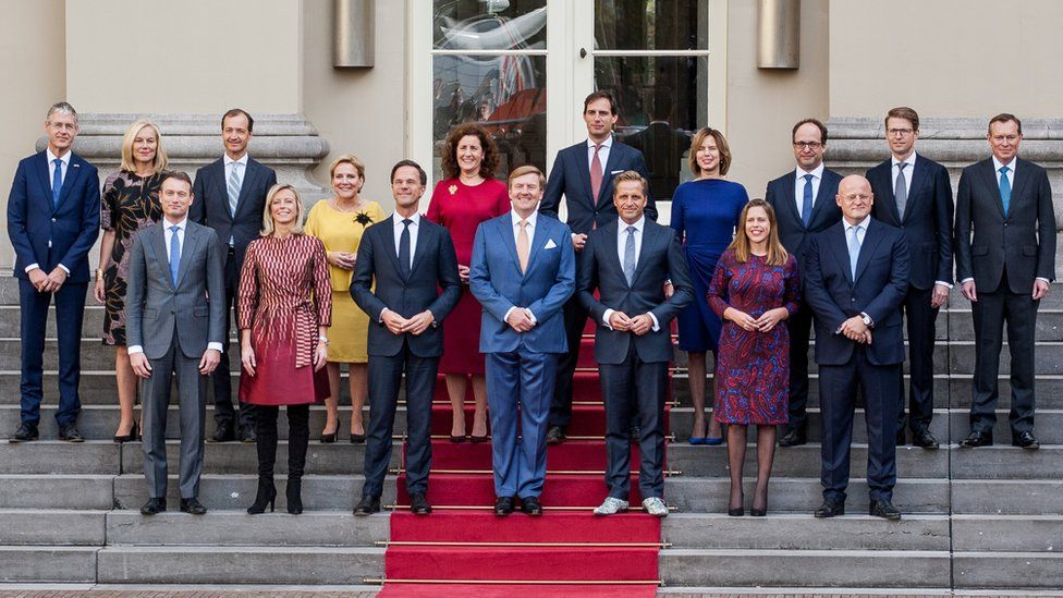 The new ministers and state secretaries of the cabinet Rutte III pose for a group photo with King Willem-Alexander (C) and Prime Minister Mark Rutte at Palace Noordeinde in The Hague, Netherlands on October 26, 2017