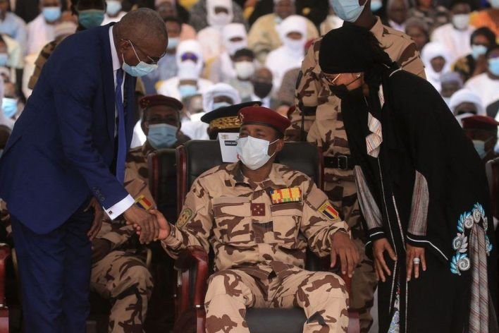The son of the late Chadian president Idriss Deby, general Mahamat Idriss Deby (C) sits in the front row as he attends the state funeral for the late Chadian president Idriss Deby in N'Djamena on April 23, 2021.