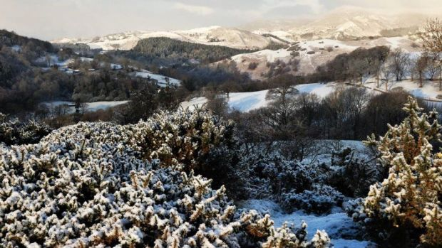 Hills around Llangollen covered in snow