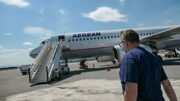 Man approaches Aegean Airlines plane