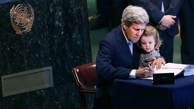 John Kerry signs the Paris accord in 2016