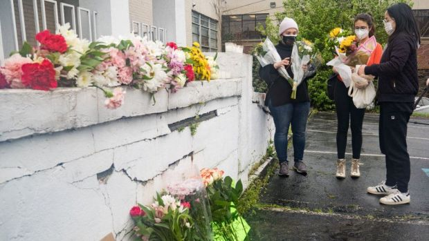 A memorial for the victims outside Young's Asian Spa