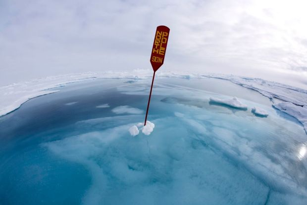 North Pole sign surrounded by water and ice