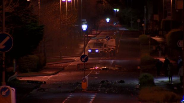 A police Land Rover close to a burning road block in Coleraine