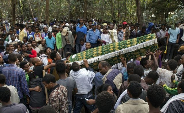The coffin of one of those lost in the collapse of a mountain of trash at a garbage dump arrives for the burial, at the Gebrekristos church in Addis Ababa, Ethiopia Monday, March 13, 2017