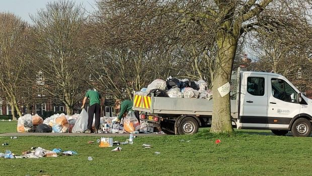 Leeds City Council workers remove litter from Woodhouse Moor