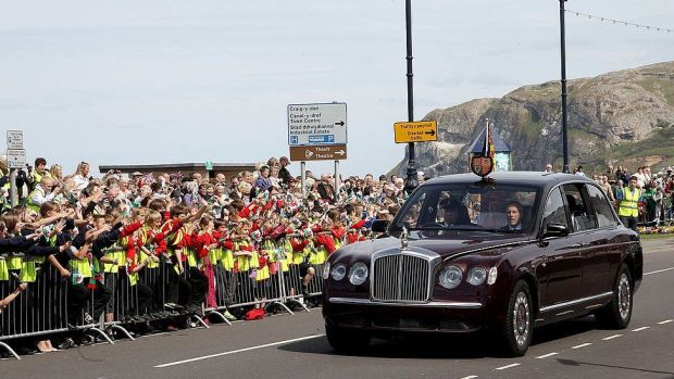 Crowds greet the Queen and Duke of Edinburgh on the seafront of Llandudno, during a two day visit in 2010