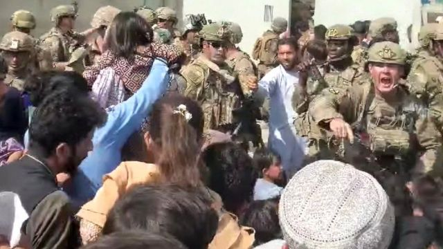 Afghanistan Special Forces try to keep a crowd from entering, outside Kabul airport, Afghanistan, 18 August 2021