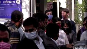 Climate change activist Disha Ravi is escorted by police officials as she walks out of the court in New Delhi, India February 14, 2021 in this still image taken from video.