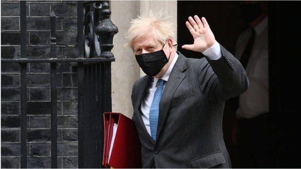 Boris Johnson leaving Downing Street for PMQs