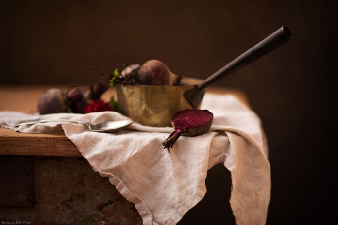 Beetroots in a pan on white fabric