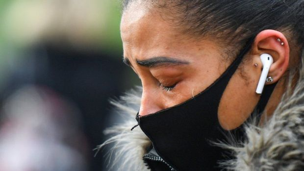 A woman cries at the memorial site