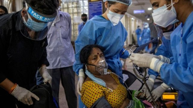 A patient suffering from the coronavirus disease Covid-19 receives treatment inside the emergency ward at Holy Family hospital in New Delhi