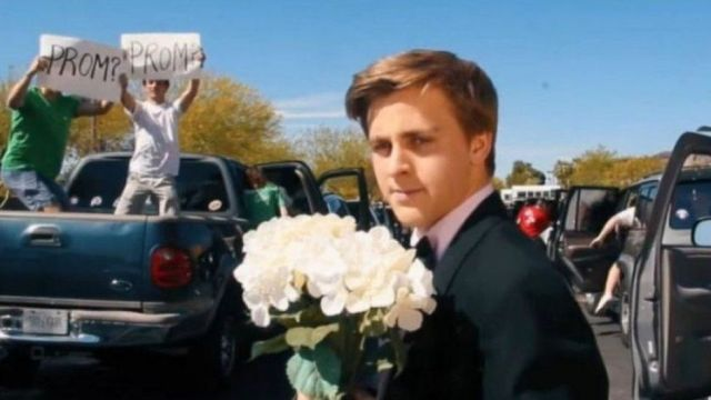 Jacob Staudenmaier holding flowers in the video