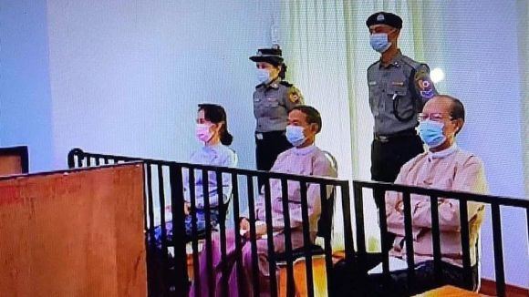 Aung San Suu Kyi in a makeshift courtroom with two other former leaders, 24 May 2021