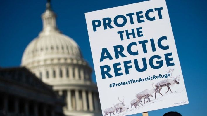 A demonstrator holds a sign against drilling in the Arctic Refuge on the 58th anniversary of the Arctic National Wildlife Refuge, during a press conference outside the US Capitol in Washington, DC, December 11, 2018.