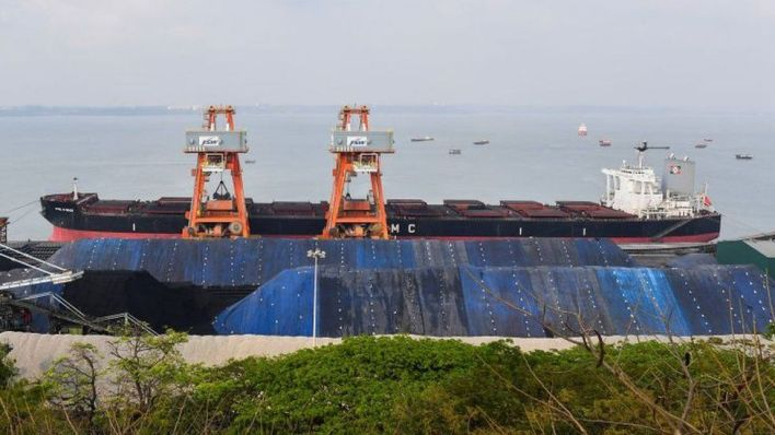 coal being unloaded at the mormugao port trust in goa.