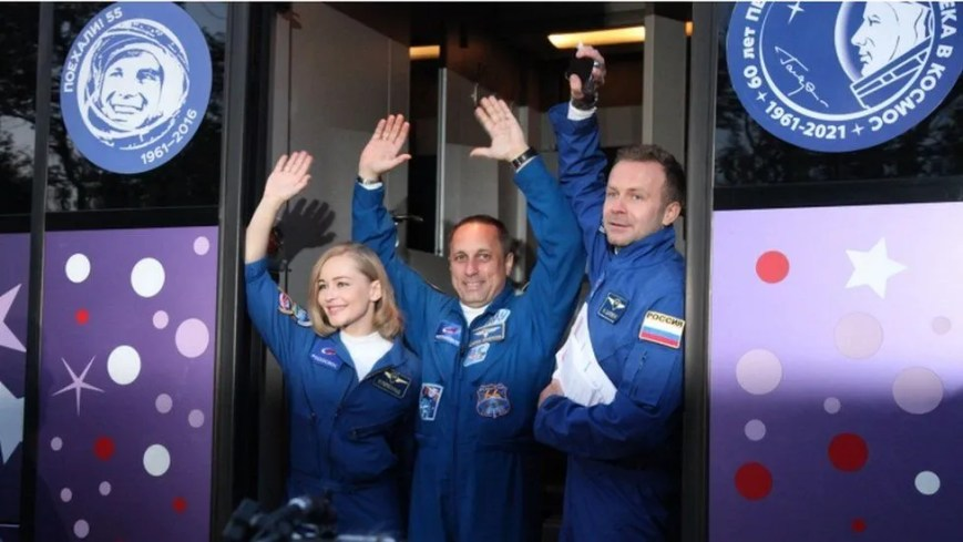 Actress Yulia Peresild, cosmonaut Anton Shkaplerov and film director Klim Shipenko, wave as they attend the send-off ceremony