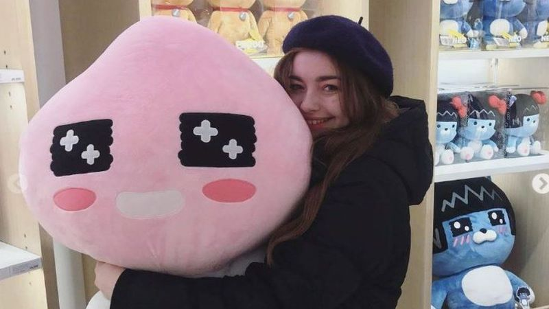 Stephanie hugging a teddy