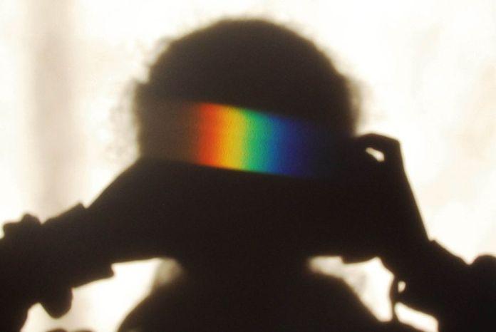 Rainbow colours on a shadow on a wall