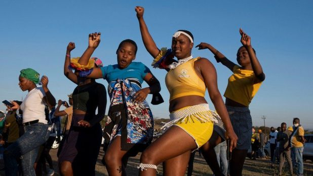 Supporters dance in front of former South African president Jacob Zuma's rural home in Nkandla on July 3, 2021