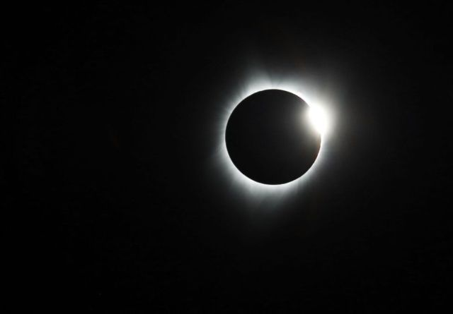 The sun reappears behind the moon during a full eclipse in Sisters Oregon, USA.