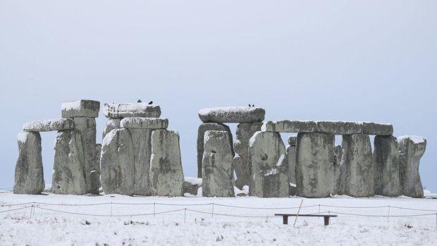 Stonehenge in snowy solitude in Wiltshire
