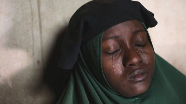 A crying mother whose two daughters were abducted