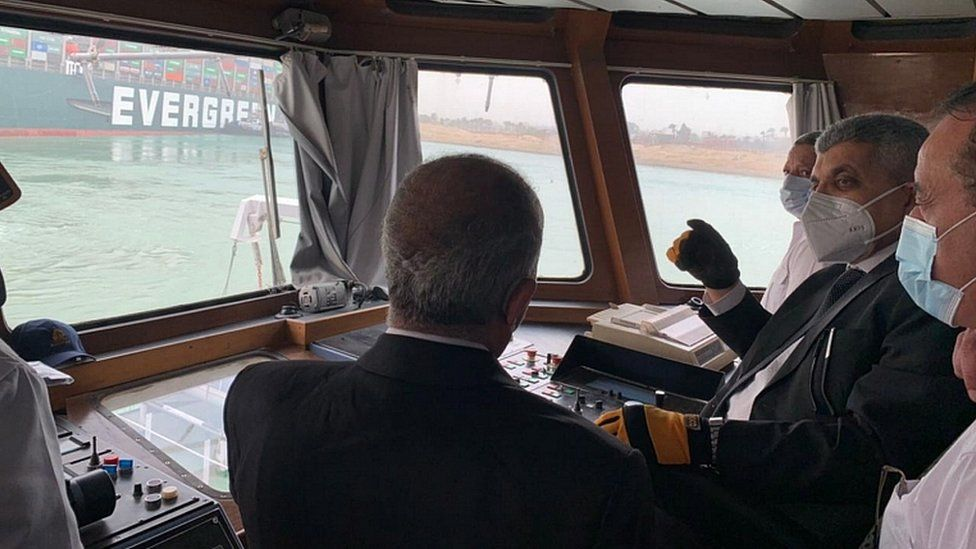 Suez Canal Authority officials visit the stranded ship