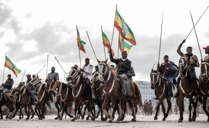 Horse riders wave the Ethiopian national flag during a rally in Addis Ababa, Ethiopia - Sunday 8 August 2021