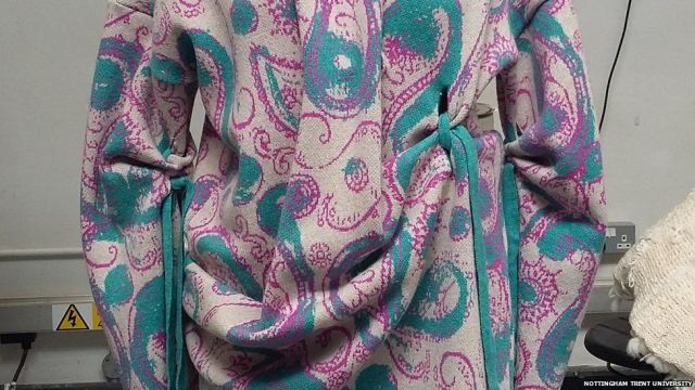 A dress with paisley pattern and drapes