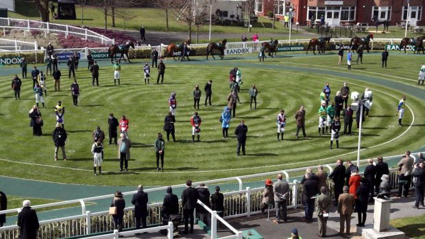 Jockeys, owners and trainers marked a two-minute silence in tribute to the duke at Aintree racecourse, Liverpool