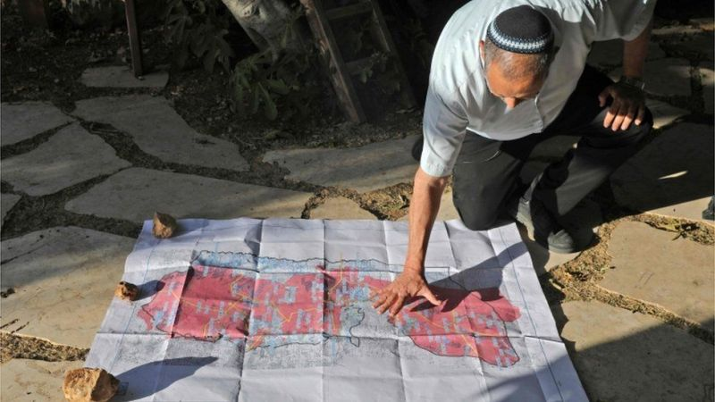 Yochai Damri, head of the Har Hebron Regional Council, shows a map of what Israeli settlers say is a map of a Palestinian state under Donald Trump's peace plan (03/06/20)