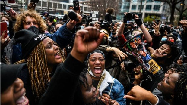People celebrate as Derek Chauvin's guilty verdict is announced