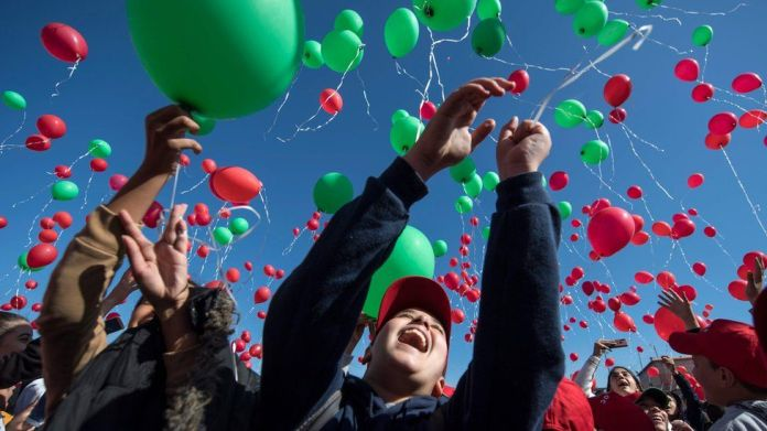Children releasing red and green balloons in Marrakesh, Morocco - Wednesday 20 November 2019