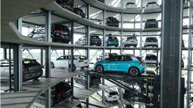 A Volkswagen ID.3 electric car stands on an elevator platform inside one of the twin towers used as storage at the Autostadt promotional facility next to the Volkswagen factory