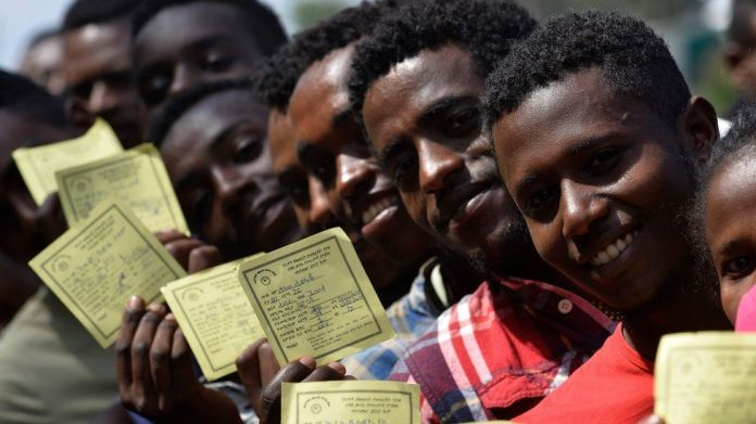 Voters pose with their identity documents during the Sidama referendum in Hawassa, Ethiopia - Wednesday 20 November 2019