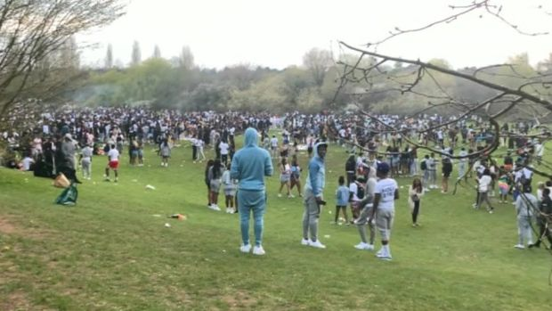 People gathered at Holders Lane playing fields in Moseley, Birmingham
