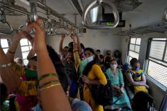 Women covering their faces with protective masks commute in a suburban train after authorities resumed the train services for all commuters after it was shut down to prevent the spread of the coronavirus disease (COVID-19) in Mumbai, India, February 1, 2021