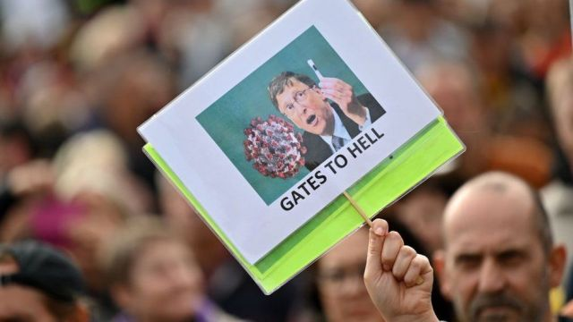 A protester holds up an anti-Bill Gates placard in Trafalgar Square in London on September 26, 2020, at a 'We Do Not Consent!' mass rally against vaccination