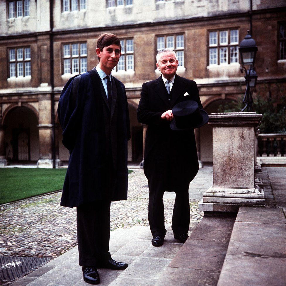 Prince Charles accompanied by head porter Mr Bill Edwards at Cambridge University