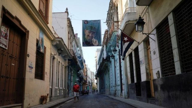 A banner displaying the portrait of late Cuban President Fidel Castro hangs on the street in downtown Havana, Cuba