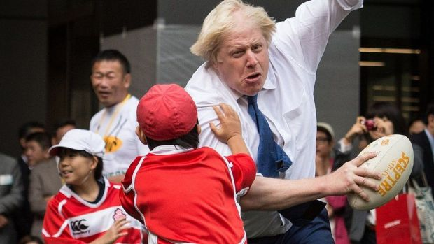 Boris Johnson joining a Street Rugby tournament in a Tokyo street with school children and adults