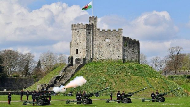 Royal Artillery fire a 41-round gun salute in the grounds of Cardiff Castle to mark the death of the Duke of Edinburgh