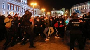 Police officers clash with demonstrators as supporters of Catalan rapper Pablo Hasél protest against his arrest in Madrid, Spain