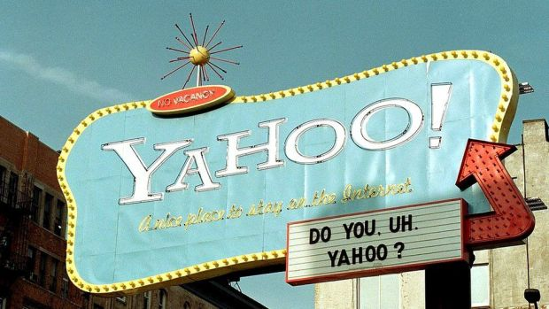 A sign for the Yahoo! Internet search engine rises above lower Manhattan in this February 10, 2000